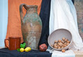 Still life with jug and walnuts Stock Images