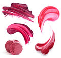 Still life of a lipstick and lip gloss rich wine and berry shades isolated on white background Royalty Free Stock Photography