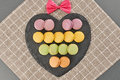 Still life macarons,heart shape, bow.Love concept Royalty Free Stock Photo