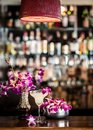 Still life with margarita cocktail and orchid flowers in the bar Royalty Free Stock Photo