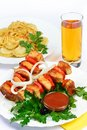 Still life with meat dumplings and juice white table food of on skewer gass of of setout table russian cuisine Stock Images