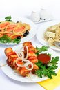 Still life with meat salmon rolls and dumplings food table white background of setout table russian cuisine Royalty Free Stock Photo