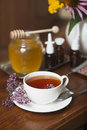 Still life from medicinal herbs honey herbal tea and medicines on a wooden background Stock Photo