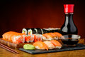 Still life with mixed sushi plate soy sauce wasabi and chopsticks Royalty Free Stock Photo