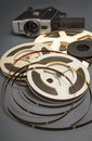 Still life of 8mm cine film reels and old movie camera. Royalty Free Stock Photo