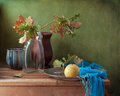 Still life with oak leaves and pear Royalty Free Stock Photo