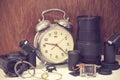 Still life with old broken alarm clock, broken camera lens, came Royalty Free Stock Photo