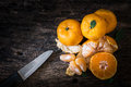 Still life oranges fruit and knife on texture wood the orange has more utility for example diet relax from smell peel or excretion Stock Photos