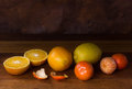 Still life with oranges and lemons isolated on wood Royalty Free Stock Photo