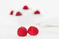 Still life with pair of raspberry on white linen table cloth copy space design ready Royalty Free Stock Photo