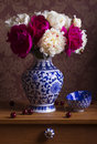Still life with peonies in a vase Royalty Free Stock Photo
