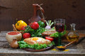 Still-life with a pie, fresh vegetables and red wine Royalty Free Stock Photo