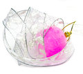 Still life from Pink velvety New Year's ball and elegant tinsel on a white background Royalty Free Stock Photo