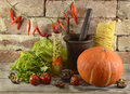Still life with pumpkin and mortar and pestle Royalty Free Stock Photo