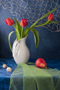 Still life with red tulips and red pear Royalty Free Stock Photo