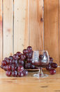 Still life red wine and grapes with wood back ground Stock Photo