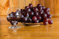 Still life red wine and grapes with wooden back ground Royalty Free Stock Photo