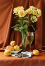 Still life with roses and glass of wine peaches chocolate Stock Image