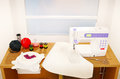 Still life with a sewing machine, embroidery, and cloth. Royalty Free Stock Photo