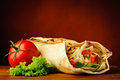 Still life with shawarma traditional homemade and vegetables Stock Photo