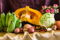 Still life split pumpkin vegetable and eggs shallots garlic dried chilli flower Royalty Free Stock Image