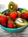 Still life of strawberries and kiwis on the table Royalty Free Stock Photo