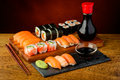 Still life with sushi mixed plate soy sauce wasabi and chopsticks Royalty Free Stock Image