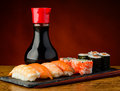 Still life with sushi plate mixed soy sauce and chopsticks Royalty Free Stock Photo