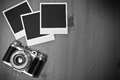 Still life three blank instant photo frames on old wooden background with old retro vintage camera with copy space Royalty Free Stock Photo