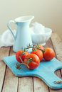 Still life with tomatoes and enamel jug Royalty Free Stock Photo
