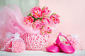 Still life with tulips and baby shoes in pink colors delicate spring tulip flowers Royalty Free Stock Photography