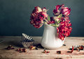 Still life with tulips red tulip flowers in porcelain can Royalty Free Stock Photo