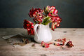 Still life with tulips red tulip flowers in porcelain can Stock Photo