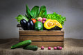 Still life vegetables vegetable variety kind of organic fresh vegetable display in wooden crate Royalty Free Stock Photos