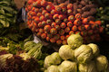 Still life with vegetables on the village market: a slide of green cabbage, a basket of bright orange carrots. Royalty Free Stock Photo