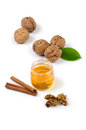 Still life with walnuts and honey Royalty Free Stock Photo