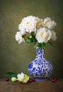 Still life with white peonies in a chinese vase on stone table Stock Photos