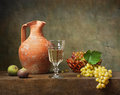 Still life with white wine and grapes Stock Photography