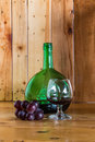 Still life wine bottle and glass red in the grapes fruit Royalty Free Stock Image