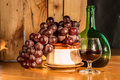 Still life wine bottle red and grapes Stock Photo
