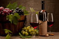 Still life with wine bottles, glasses and grapes Royalty Free Stock Photo
