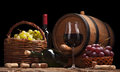 Still life with wine bottles, glasses and oak barrels Royalty Free Stock Photo