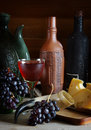 Still life with wine grape and cheese on wooden surface Royalty Free Stock Photo