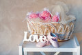 Still life with wooden love letters baby s shoes and wicker basket Royalty Free Stock Photography