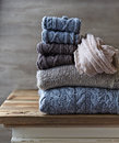 Still life with wool sweaters and leg warmers gray brown Royalty Free Stock Photo
