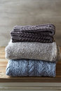 Still life with wool sweaters and leg warmers gray brown Royalty Free Stock Photography