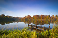 Still waters of a lake in autumn fishermen doze boat on an english under sunshine Royalty Free Stock Images