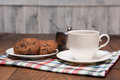 Stilllife with a cup sugar bowl and saucer with cookies picture of represented on table top cloth on wooden table Stock Images