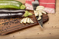 Stilllife with cutted eggplant slices kitchen knife Stock Images