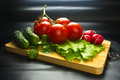 Stilllife - tomatoes, cucumbers, lettuce Royalty Free Stock Photo